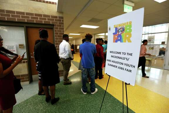 Potential employees line up during a job fair for youth ages 16-24 at Worthing High School on Saturday, April 29, 2017. (Annie Mulligan / Freelance)