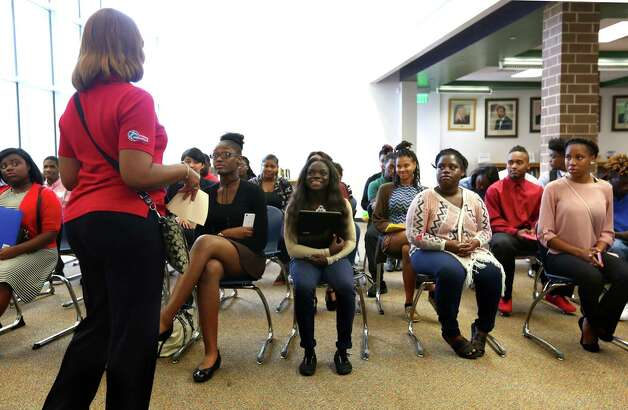 Young adults ages 16-24 listen to Sharon Malveaux, Workforce Development Specialist for the City of Houston, after filling out a preliminary application during the Hire Houston Youth at Worthing High School on Saturday, April 29, 2017. Six employers - HEB, Kroger, Walmart, McDonalds, Jack in the Box and Fiesta - interviewed potential employees for summer jobs. (Annie Mulligan / Freelance) Photo: Annie Mulligan / For The Houston Chronicle / @ 2017 Annie Mulligan
