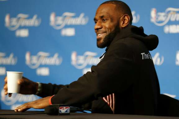 Cleveland Cavaliers' LeBron James jokes that he is going to sign all the top free agents when he owns a team at end of press availability during practice day during NBA Finals at Quicken Loans Arena in Cleveland, Ohio, on Thursday, June 8, 2017.