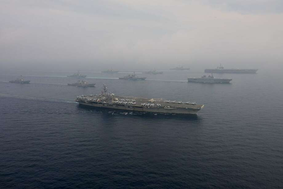 American and Japanese warships sail the seas between Japan and the Korean Peninsula on June 1 during an exercise designed to serve as a warning to an increasingly belligerent Pyongyang. Photo: KENNETH ABBATE, NYT