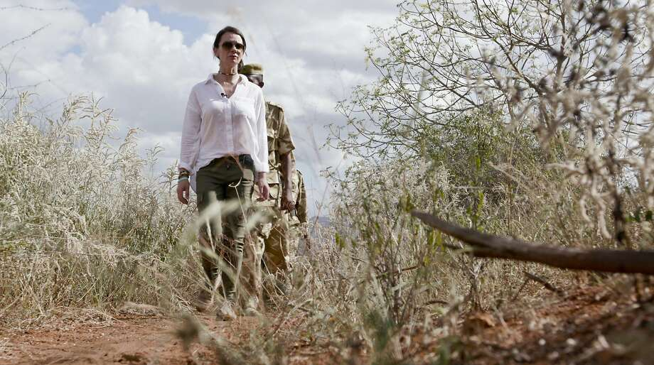 Faye Cuevas and a field unit of the Kenya Wildlife Service search for signs of poaching last year in Tsavo East National Park. Photo: Nina Schwendemann, Associated Press