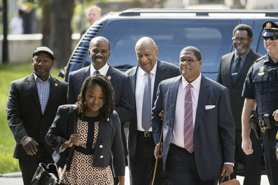 Bill Cosby (center) walks to court in Norristown, Pa., where a police officer testified about a report he wrote in 2005 after interviewing Cosby about an alleged sexual assault. Photo: Matt Rourke, Associated Press
