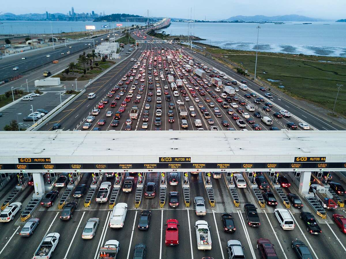Traffic flows through the Bay Bridge toll plaza on Thursday, June 8, 2017, in Oakland, Calif.