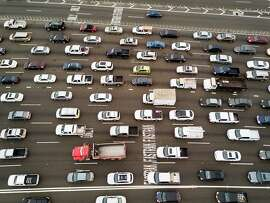 Cars approach the Bay Bridge toll plaza on Thursday, June 8, 2017, in Oakland, Calif.