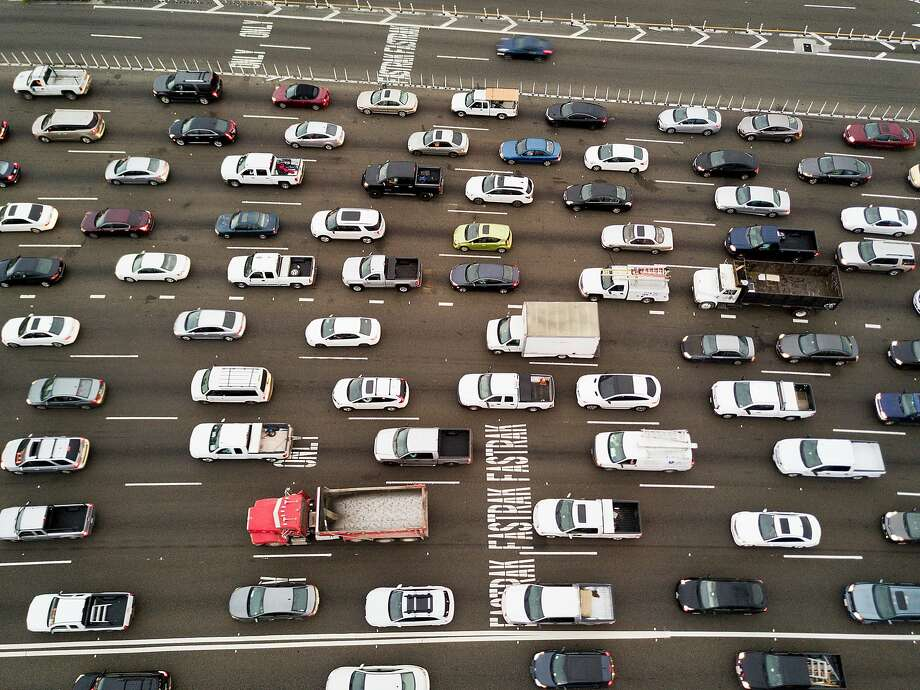 Cars approach the Bay Bridge toll plaza on June 8. Photo: Noah Berger, Special To The Chronicle
