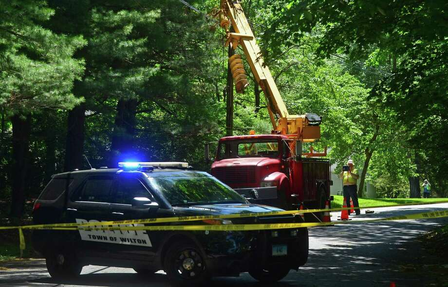 Wilton Police and Eversource employees investigate a workplace accident scene on Rivergate Drive in Wilton, Conn. that killed 44-year-old Marco Silva of Danbury on Thursday, June 9, 2016. Photo: Erik Trautmann / Hearst Connecticut Media / (C)2016, The Connecicut Post, all rights reserved