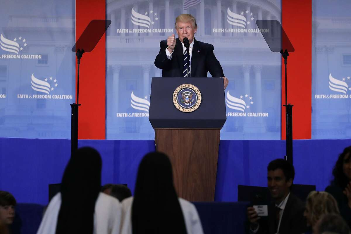 President Donald Trump gives a thumbs-up to a pair of nuns in attendance as he delivers remarks at the Faith and Freedom Coalition's Road To Majority conference in Washington, Thursday, June 8, 2017. (AP Photo/Patrick Semansky)