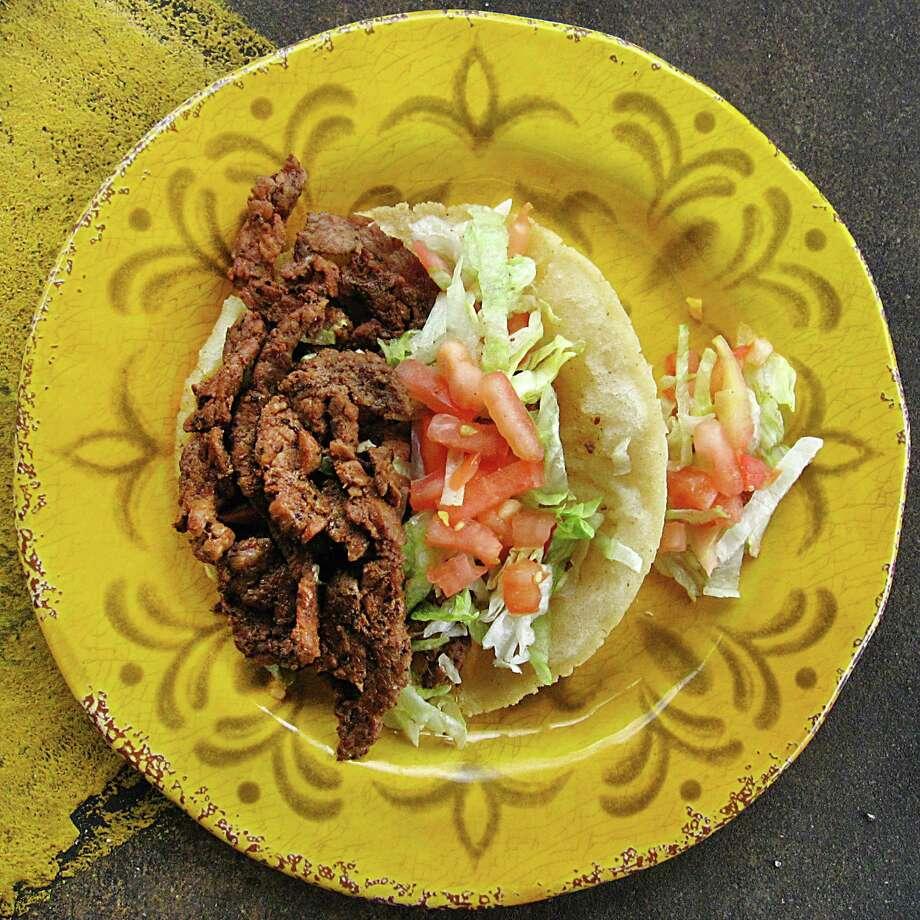 Taco of the Week: Beef fajita puffy taco from Oscar's Taco House. Photo: Mike Sutter /San Antonio Express-News