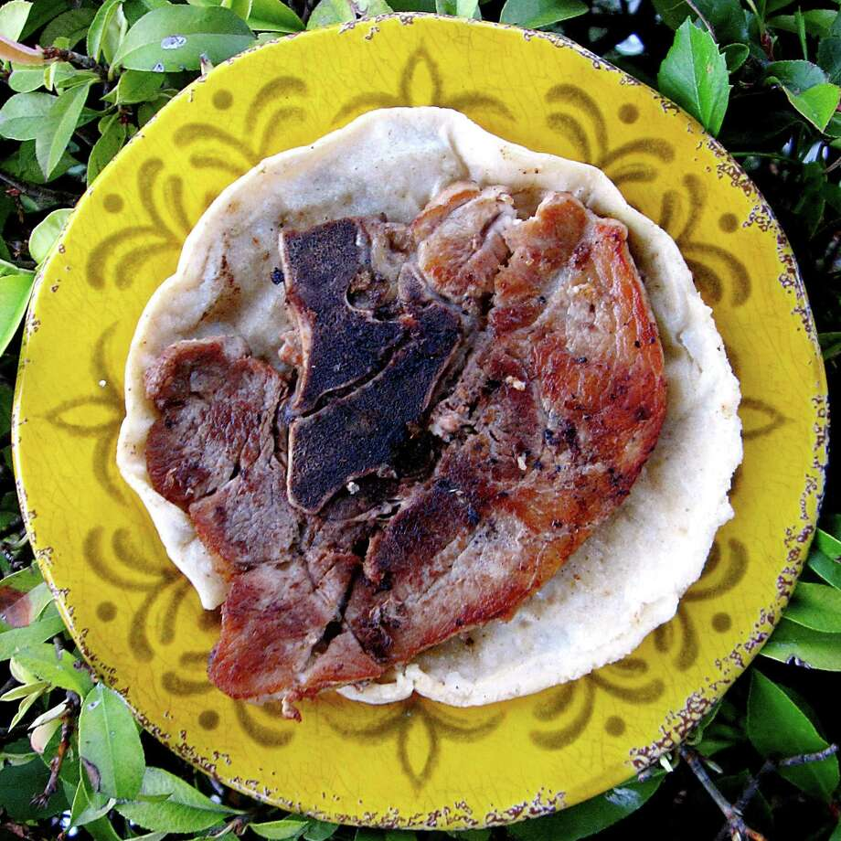 Pork chop taco on a handmade corn tortilla from Rocky's Taco House. Photo: Mike Sutter /San Antonio Express-News