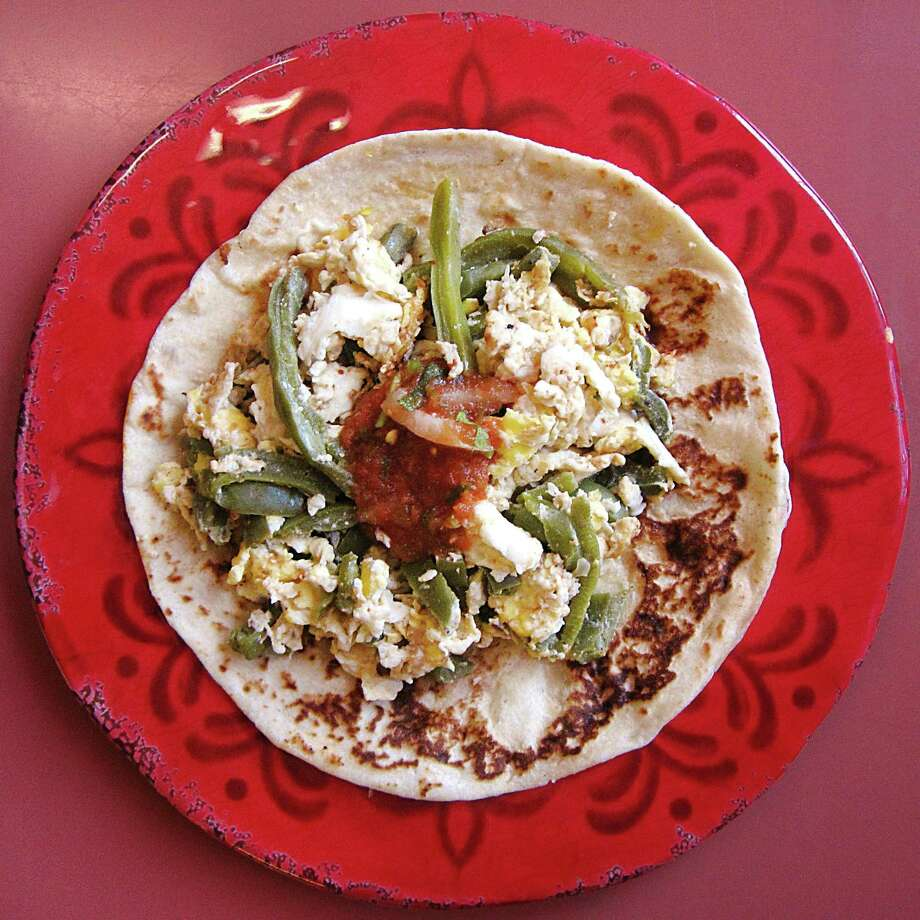 Nopales and egg taco on a handmade flour tortilla from La Cavaña Mexican Restaurant. Photo: Mike Sutter /San Antonio Express-News