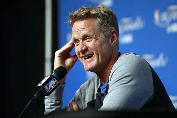 Golden State Warriors' head coach Steve Kerr laughs during press availability on practice day during NBA Finals at Quicken Loans Arena in Cleveland, Ohio, on Thursday, June 8, 2017.