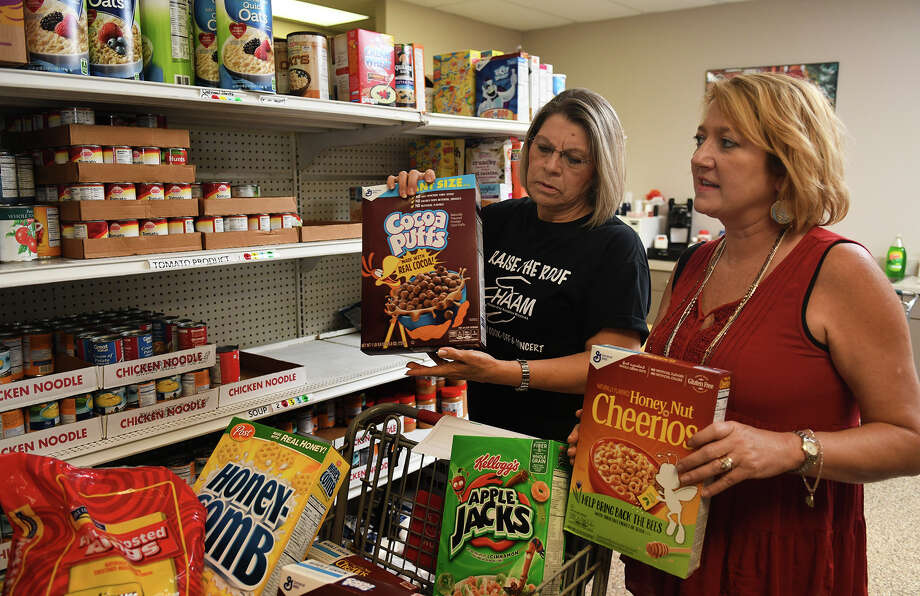 Humble Area Assistance Ministries (HAAM) Food Pantry volunteer Maria Rodriguez, left, and HAAM Executive Director Millie Garrison fill an order in the pantry on June 7, 2017. (Photo by Jerry Baker/Freelance) Photo: Jerry Baker, Freelance / Freelance