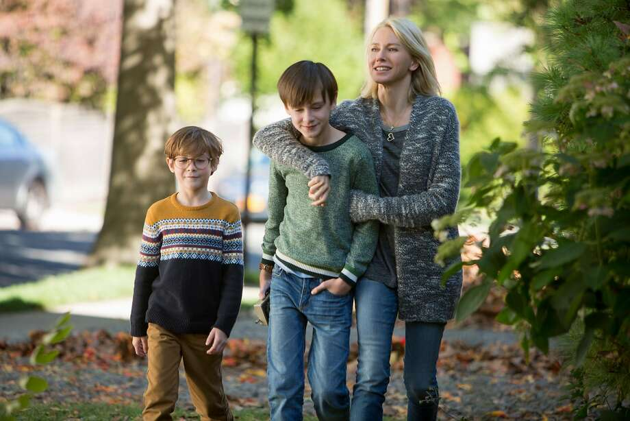 """Peter (Jacob Tremblay, left) and Henry (Jaeden Lieberher), the family financial manager, are the sons of single mom and waitress Susan (Naomi Watts) in """"The Book of Henry."""" Photo: Alison Cohen Rosa / Focus Features"""