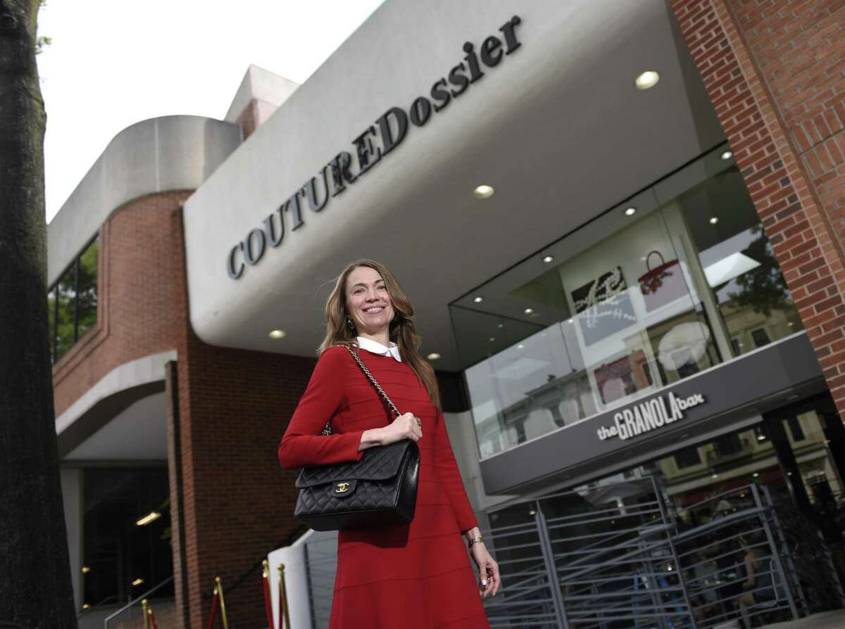 Owner Yulia Omelich poses outside her store Couture Dossier on Greenwich Avenue in Greenwich, Conn. Thursday, June 8, 2017. The store offers luxury retail fashions at a discount and recently opened at the top of Greenwich Avenue above Granola Bar.