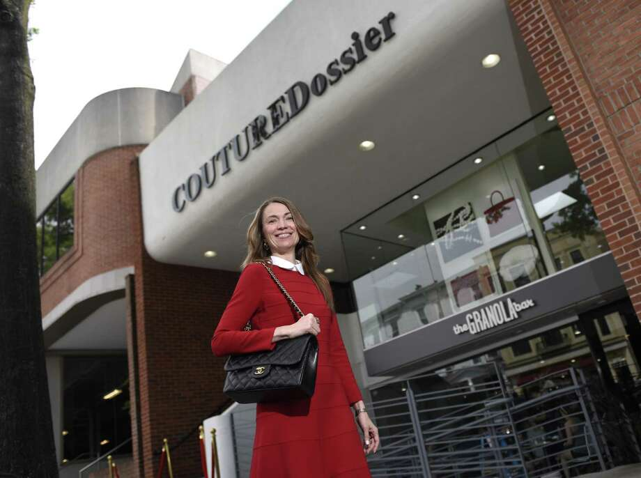 Owner Yulia Omelich poses outside her store Couture Dossier on Greenwich Avenue in Greenwich, Conn. Thursday, June 8, 2017. The store offers luxury retail fashions at a discount and recently opened at the top of Greenwich Avenue above Granola Bar. Photo: Tyler Sizemore / Hearst Connecticut Media / Greenwich Time