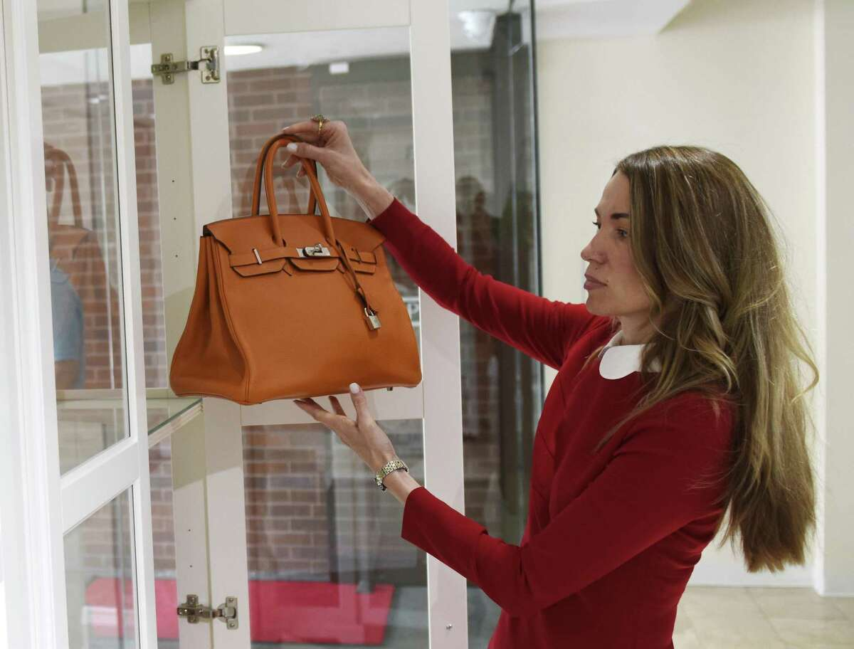 Owner Yulia Omelich shows a Hermès Birkin bag for sale at Couture Dossier on Greenwich Avenue in Greenwich, Conn. Thursday, June 8, 2017. The store offers luxury retail fashions at a discount and recently opened at the top of Greenwich Avenue above Granola Bar.