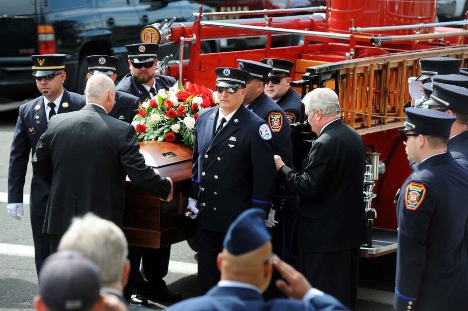 """The casket of Seymour Volunteer Firefighter Kirk """"Mike"""" Weldon arrives at Assumption Church, in Ansonia, Conn. for his funeral service June 8, 2017. Photo: Ned Gerard / Hearst Connecticut Media / Connecticut Post"""