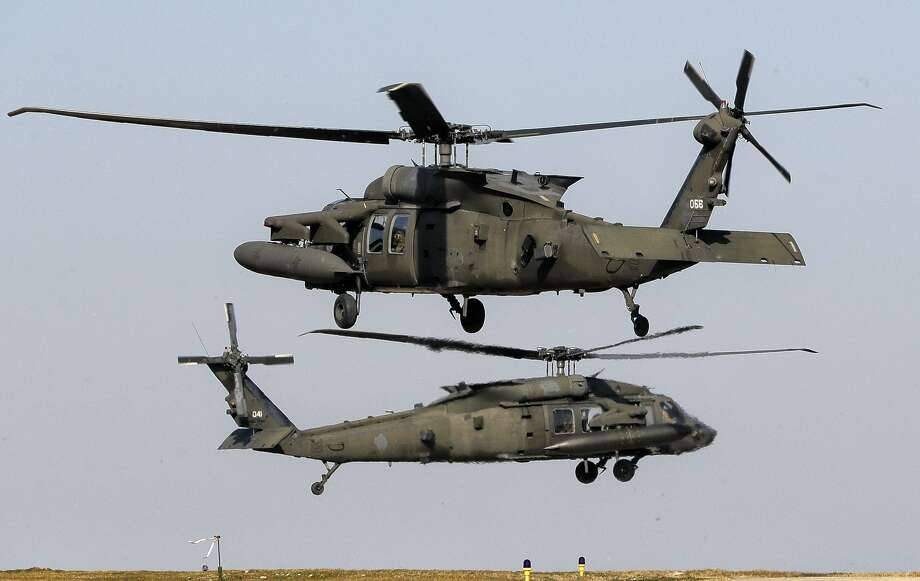 Sikorsky-built U.S. Army UH-60 Blackhawk helicopters take off in Romania. A much-publicized $100 billion deal with Saudi Arabia that included Sikorsky helicopters turns out to be less than was advertised. Photo: AP Photo /Vadim Ghirda / Associated Press / Copyright 2017 The Associated Press. All rights reserved.