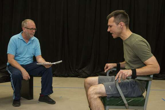 """Andrew Thornton (left) and Zach Lewis rehears a scene for """"Nine Circles,"""" the first production for the Surround Project."""