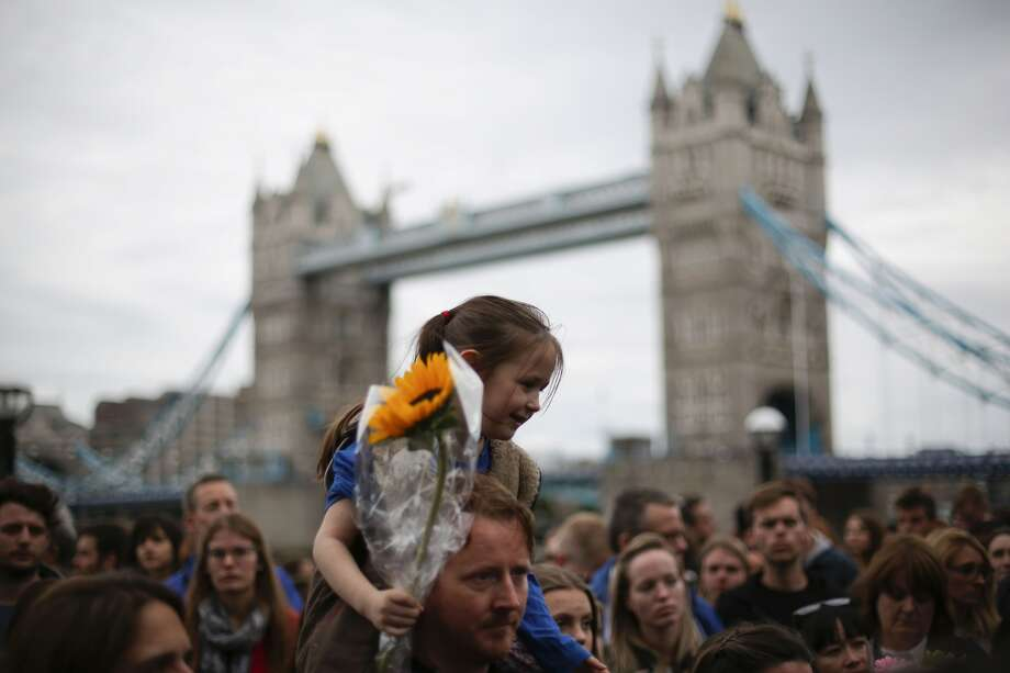Londoners gather for a vigil at Potters Field Park, near where a group of terrorists attacked people in the Borough Market and on the iconic London Bridge, killing at least seven people. Photo: Daniel Leal-Olivas / Getty Images