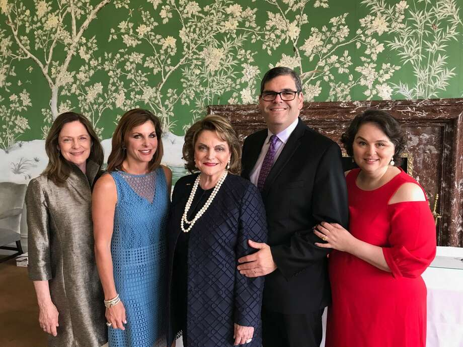 Beth Wolff (center) of Beth Wolff Realtors Real Living celebrates her installation as president of the Houston Symphony League with (left to right) Marie Caplan, Cynthia Peatross, and Ed and Katy Wolff.