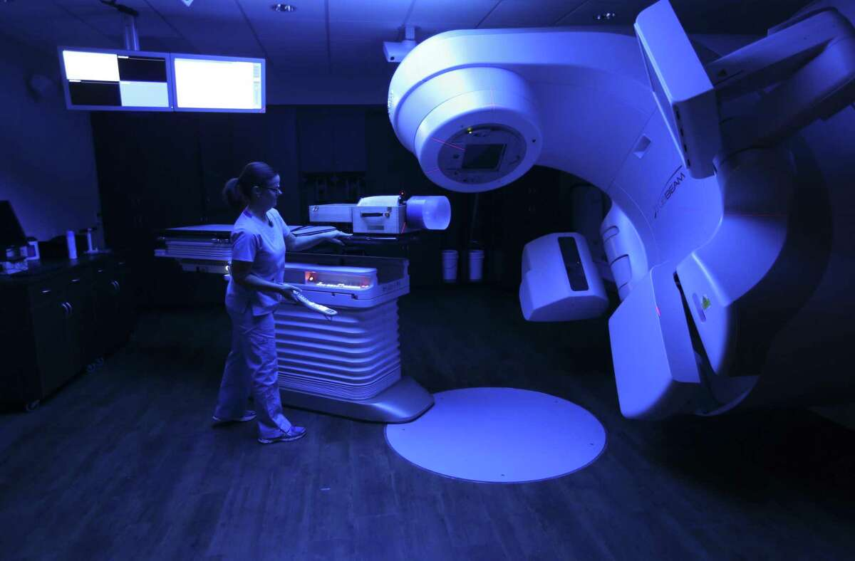 Jennifer Siliezar, a senior radiation therapist, works Wednesdaywith a Truebeam varian linear accelerator at Texas Oncology's newly opened Research Drive facility.