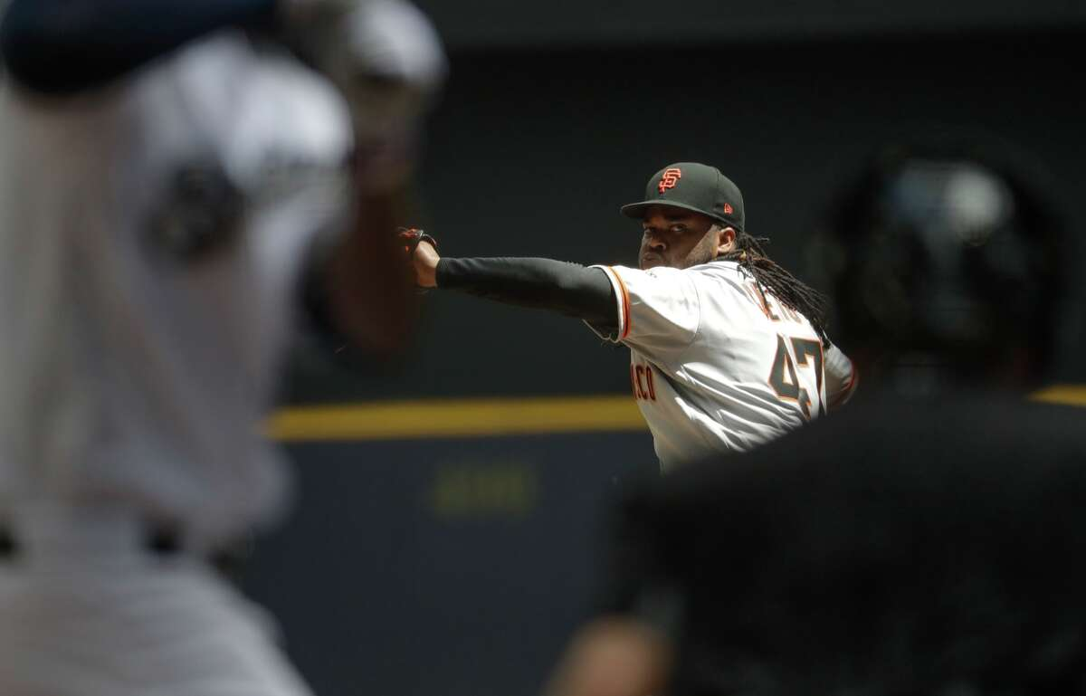 San Francisco Giants starting pitcher Johnny Cueto throws during the third inning of a baseball game against the Milwaukee Brewers Thursday, June 8, 2017, in Milwaukee. (AP Photo/Morry Gash)