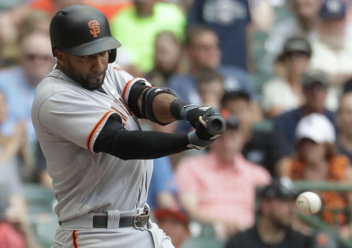 San Francisco Giants' Eduardo Nunez hits an RBI single during the sixth inning of a baseball game against the Milwaukee Brewers Thursday, June 8, 2017, in Milwaukee. (AP Photo/Morry Gash)