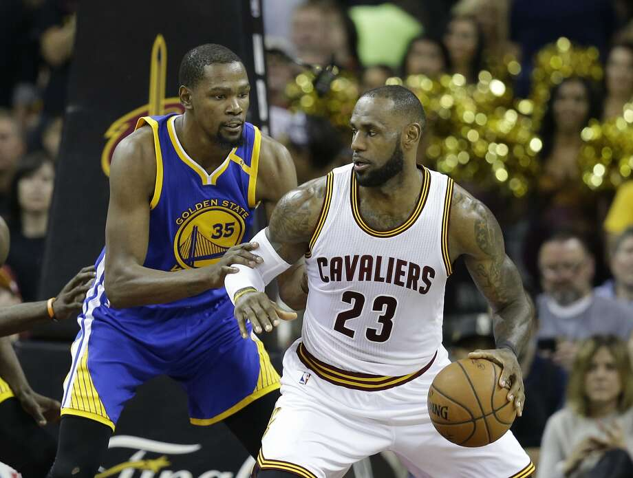 Golden State Warriors forward Kevin Durant (35) defends Cleveland Cavaliers forward LeBron James (23) during the second half of Game 3 of basketball's NBA Finals in Cleveland, Wednesday, June 7, 2017. (AP Photo/Tony Dejak) Photo: Tony Dejak, Associated Press