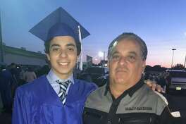 Leroy Solis Jr. and his father, Leroy Solis Sr. The teen was able to participate in the MacArthur High School graduation, after nearly missing it due to his jeans, thanks to the kindness of a stranger who swapped pants with him.