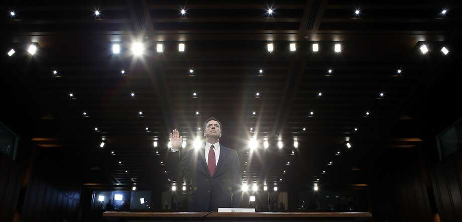 Ex-FBI chief James Comey is sworn in and testifies at a Senate Intelligence Committee hearing about meetings with the president. Photo: Alex Brandon, Associated Press