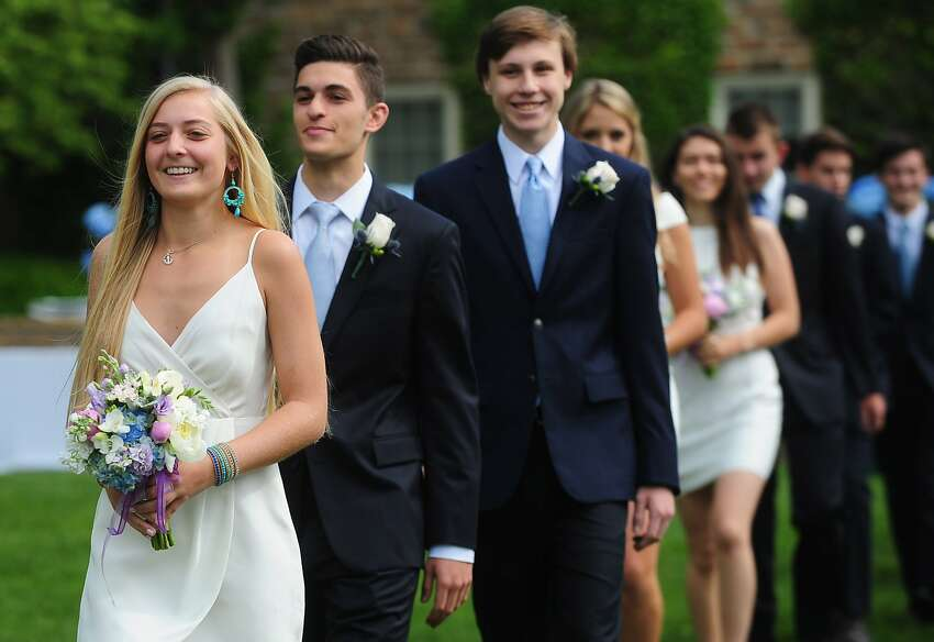 Lauren Ritchey of Norwalk walks in the processional Greens Farms Academy Class of 2017 graduation Thursday, June 8, 2017, at the school in Westport, Conn.