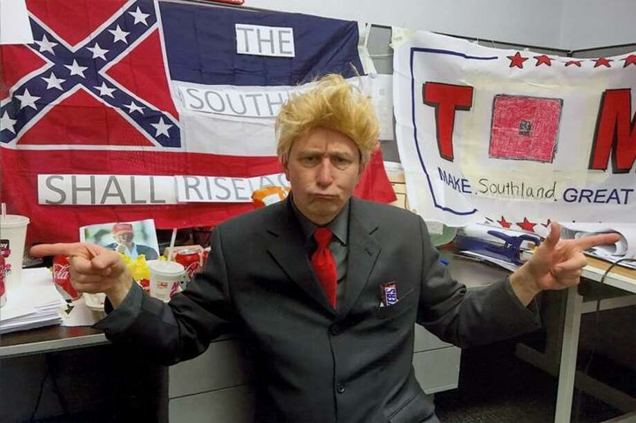 Tishay Wright said her former boss Kenneth Hayden gave her this photo of himself dressed as President Trump in front of a Confederate flag.