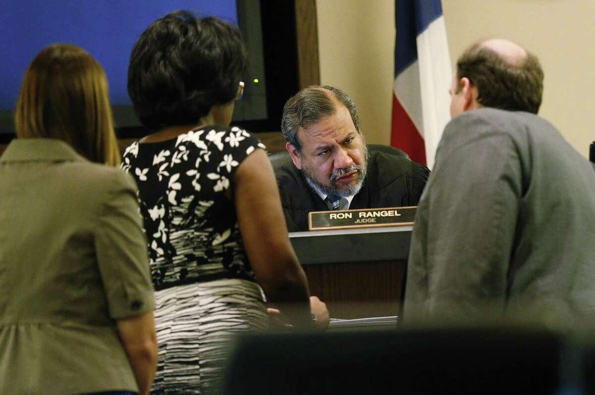 Judge Ron Rangel confers with attornies as testimony continues in the murder trial of Joel Soto, accused of setting a fire in his pickup to hide the fact that his two-year-old grandson, Jeremy Soto, was already dead, possibly from ingesting methamphetamine. The trial continued in 379th state District Court, at Cadena-Reeves Justice Center on Thursday, June 8, 2017. (Kin Man Hui/San Antonio Express-News)