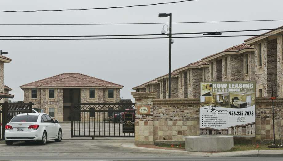 "A ""Now Leasing"" sign is seen outside an apartment complex in Laredo. According to a report released Thursday by the National Low Income Housing Coalition, there is nowhere in this country where someone working a full-time minimum wage job could afford to rent a two-bedroom apartment. Photo: Laredo Morning Times File Photo / LAREDO MORNING TIMES"