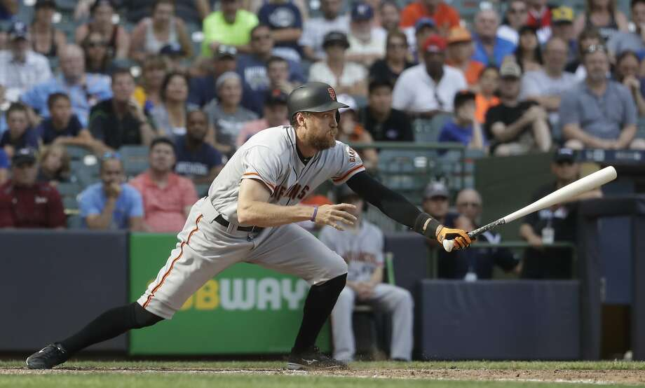 San Francisco Giants' Hunter Pence hits an RBI single during the 10th inning of a baseball game against the Milwaukee Brewers Thursday, June 8, 2017, in Milwaukee. (AP Photo/Morry Gash) Photo: Morry Gash, Associated Press