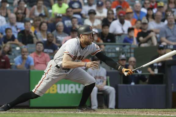 San Francisco Giants' Hunter Pence hits an RBI single during the 10th inning of a baseball game against the Milwaukee Brewers Thursday, June 8, 2017, in Milwaukee. (AP Photo/Morry Gash)