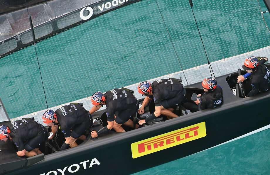 The crew of Emirates Team New Zealand appears locked in while racing Britain's Land Rover BAR during an America's Cup challenger semifinals on the Great Sound in Bermuda. Photo: Ricardo Pinto, Associated Press