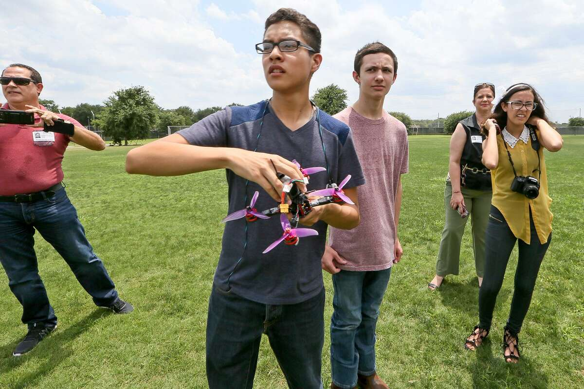Emmanuel Corona holds the Roosebelt High School Data Drone Club's self-built drone after it's maiden flight at the school on Tuesday, May 30, 2017.