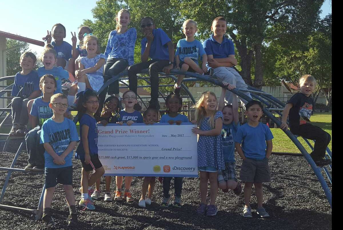 Randolph Elementary students climb on the school's jungle gym dome May 25, showing off a $60,000 award the school received for new playground equipment.