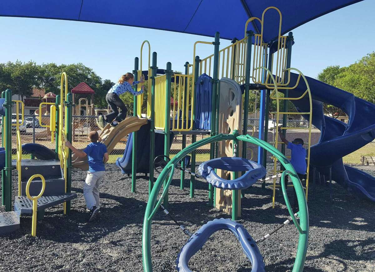 A Randolph student climbs one of two play systems currently on the military-based school's playground.