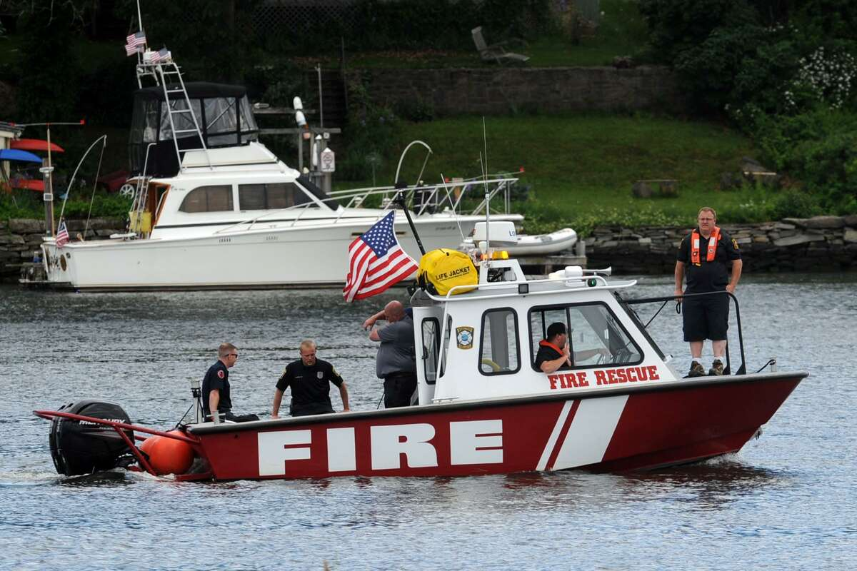 A fire rescue boat searches the Housatonic River below the Washington Bridge, in Stratford Wednesday following a report that a person fell or jumped from the bridge. The search for the body of Tavares Harris, 26, continued Thursday.