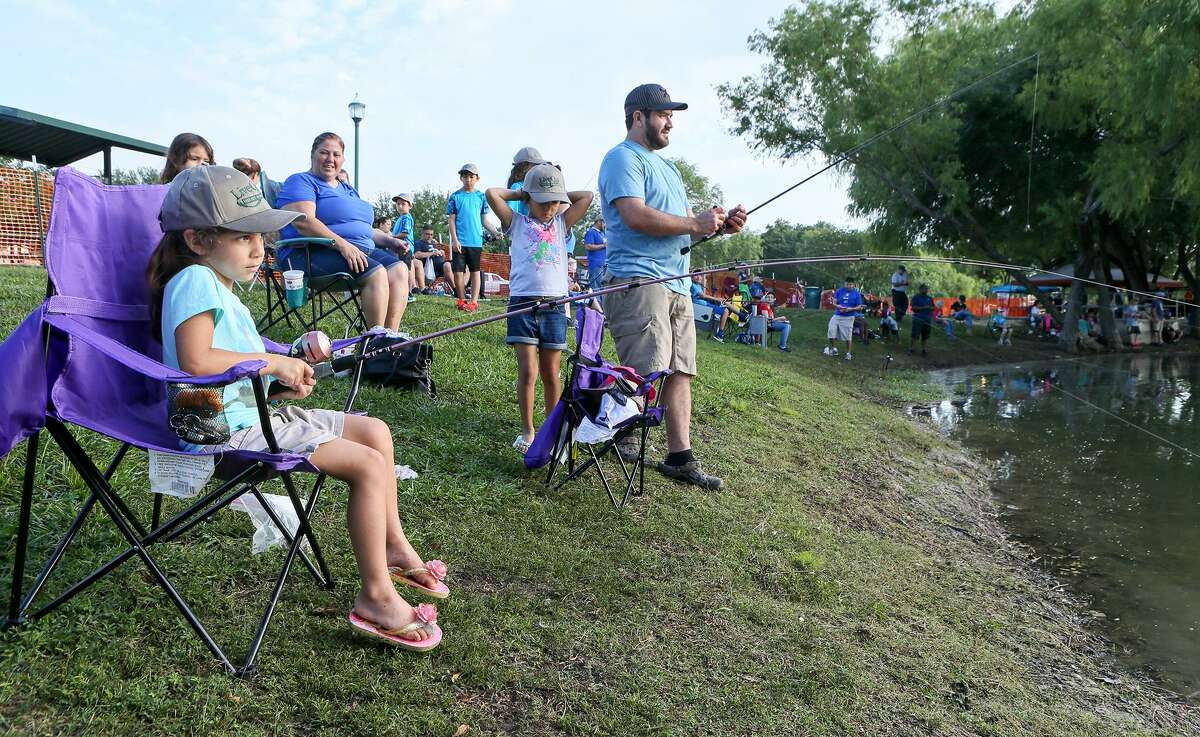 Mollie Hernandez, 4, patiently waits for a bite while fishing in the annual Live Oak Junior Fishing Day at Live Oak Park on Saturday, June 3, 2017. MARVIN PFEIFFER/ mpfeiffer@express-news.net
