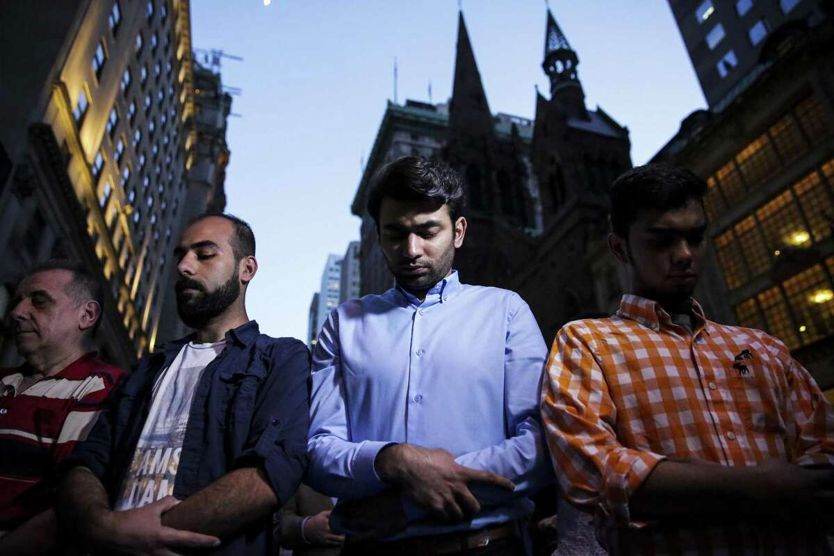 Demonstrators pray outside of Trump Tower in New York City on June 1 to express objections to President Trump's travel ban. In a tweet, the president disclosed that a ban is precisely what it is.