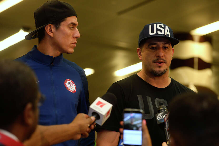 Steven Lopez, taekwondo athlete, listens as his brother and coach, Jean, talks to the media after they arrive home from the Rio Olympics at the George Bush International Airport in Houston on Tuesday morning.  Photo taken Tuesday 8/23/16 Ryan Pelham/The Enterprise Photo: Ryan Pelham/Ryan Pelham/The Enterprise