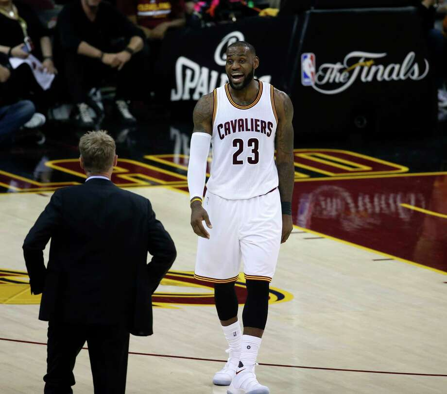 Cleveland Cavaliers forward LeBron James (23) talks to Golden State  Warriors coach Steve Kerr 92e5eb55d