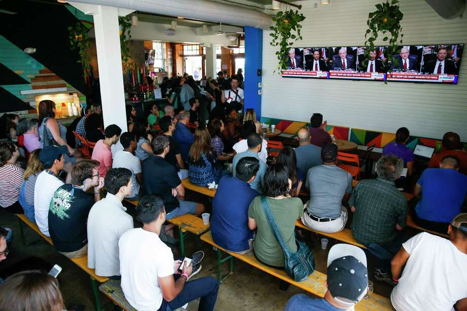 Scores of people pack the Axelrad Beer Garden to watch former FBI director James Comey testify Thursday before the Senate Intelligence panel. Photo: Michael Ciaglo, Staff / Michael Ciaglo
