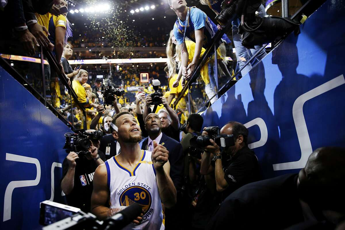 Golden State Warriors guard Stephen Curry (30) exits the court following Game 2 of the NBA Finals between the Golden State Warriors and the Cleveland Cavaliers on Sunday, June 4, 2017, at Oracle Arena in Oakland, Calif.