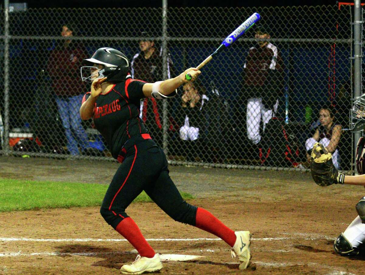 Pomperaug's Laurel Williams gets a seventh-inning hit against Torrington during the Class L semifinals Thursday in West Haven.