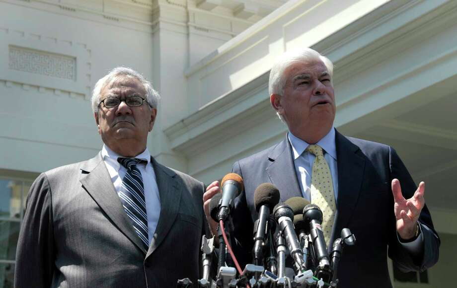 Sen. Christopher Dodd, D-Conn., right, and Rep. Barney Frank, D-Mass., speak in 2010 about their financial reform law, known as Dodd-Frank.  Photo: Susan Walsh, STF / AP2010